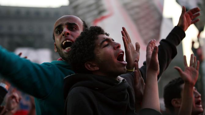 Egyptian protesters chant slogans as thousands of soccer fans of Egypt's most popular team, Al-Ahly, rally in Tahrir Square, the focal point of  the Egyptian uprising, in Cairo, Egypt, Friday, Jan. 18, 2013. Fans called for revenge a week before a court verdict is expected over last year's Port Said football stadium disaster, which killed 72 fans. (AP Photo/Khalil Hamra)