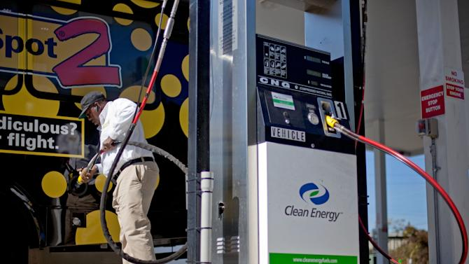 FILE - In this Thursday, Oct. 27, 2011 file photo, motorist Bob Davis fills up his airport shuttle van at a natural gas pumping station in College Park, Ga. Years from now, motorists needing a fill-up might see natural gas pumps sharing space at the neighborhood filling station with ones dispensing gasoline and diesel. (AP Photo/David Goldman, File)