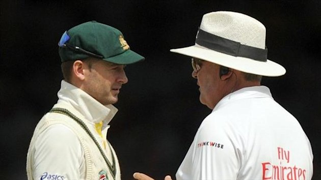 Michael Clarke, left, believes Australia can still win the Ashes