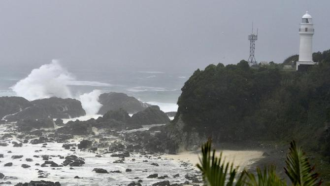 Sea waves break in Kushimoto, western Japan, Sunday, Aug. 10, 2014. A tropical storm was moving out into the Sea of Japan on Sunday after lashing the country with rain and winds, leaving one person dead, more than 50 injured and prompting evacuation alerts for about 1.2 million residents near swollen rivers. (AP Photo/Kyodo News) JAPAN OUT