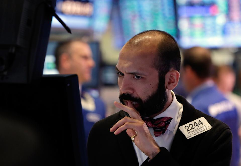 Stocks close higher despite looming budget cuts