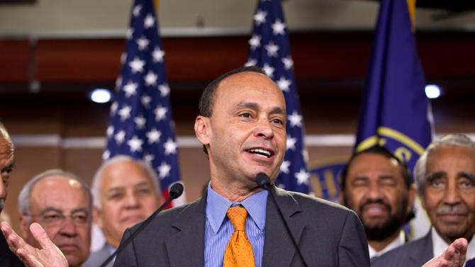 "FILE - In this Aug. 2, 2012 file photo, Rep. Luis Gutierrez, D-Ill., center, accompanied by fellow House members, speaks during a news conference on Capitol Hill in Washington.  House members writing a bipartisan immigration bill said Thursday they had patched over a dispute that threatened their efforts, even as they and the rest of Congress prepared to return home for a weeklong recess where many could confront voter questions on the issue. ""I'm very pleased,"" said Gutierrez. ""We're going to get there. There's going to be justice done for our immigrant community."" (AP Photo/J. Scott Applewhite)"
