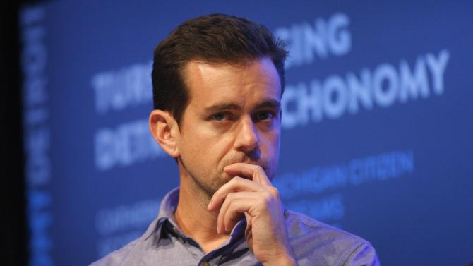 Dorsey, chairman of Twitter and CEO of Square, listens to a fellow panelist during a Techonomy Detroit panel discussion held at Wayne State University in Detroit