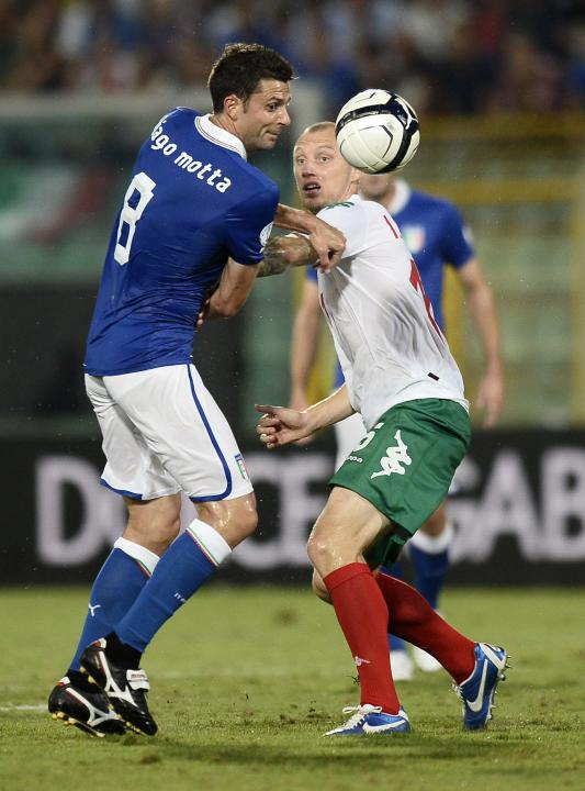 Italy's Motta fights for the ball with Bulgaria's Ivanov during their World Cup qualifying soccer match at the Renzo Barbera Stadium in Palermo