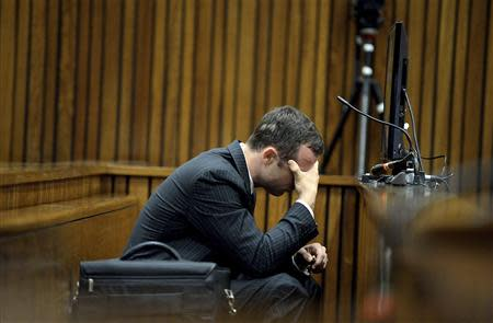 Olympic and Paralympic track star Oscar Pistorius reacts during a testimony at the North Gauteng High Court in Pretoria