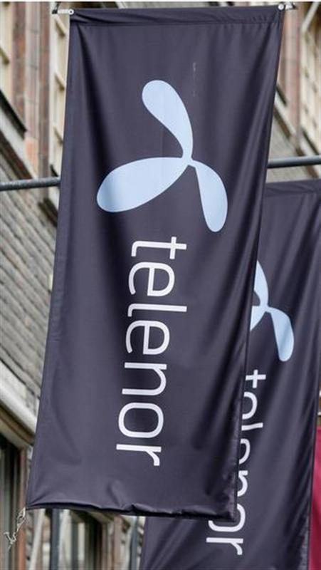 The Telenor logo hangs on flags outside one of their stores in Stockholm
