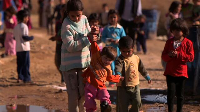 Syrian refugee children work in fields to support families