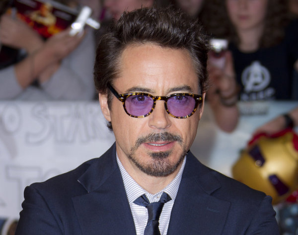 "FILE - In this April 19, 2012 file photo, actor Robert Downey Jr arrives for the European Premiere of ""The Avengers,"" in London. Representatives at Marvel Entertainment announced that Downey Jr. sustained an injury to his foot while performing a stunt on the set of ""Iron Man 3."" Marvel says there will be a short delay in production while Downey recuperates. (AP Photo/Joel Ryan, file)"