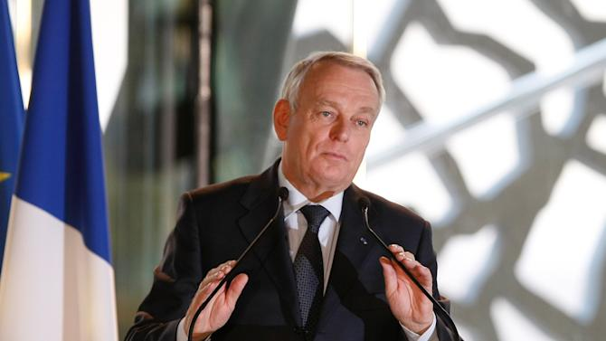 "French First Minister Jean-Marc Ayrault delivers his New Year wishes ceremony speech, to the world of culture, in Marseille, southern France, Saturday, Jan. 12, 2013, at the occasion of the launch of ""Marseille - Provence 2013, European capital of the culture"". (AP Photo/Claude Paris)"