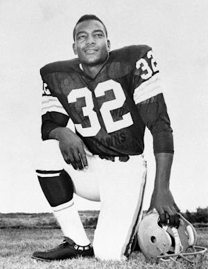 FILE - This undated file photo shows Cleveland Browns running back Jim Brown posing for a team photo. Jim Brown and the Cleveland Browns are getting back together. The Hall of Fame running back, who has had a rift with his former team for several years, plans to take part in alumni events this weekend when the Browns host the Buffalo Bills on Sunday, Sept. 23, 2012. (AP Photo/File)