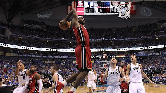 Miami Heat's LeBron James dunks during the second half of Game 3 of the NBA Finals basketball game against the Dallas Mavericks Sunday, June 5, 2011, in Dallas. The Heat won 88-86 take a 2-1 lead in the series. (AP Photo/Mike Ehrmann; Pool)