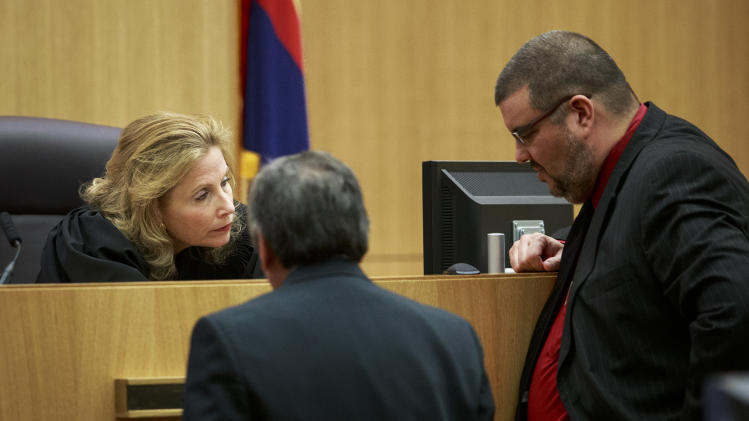 Maricopa County Superior Court Judge Sherry Stephens meets with Prosecuting Attorney Juan Martinez and Defense Attorney Kirk Nurmi as defendant Jodi Arias testifies on her behalf during her murder trial in Judge Sherry Stephens' Superior Court in Phoenix, on Tuesday, Feb. 5, 2013. Arias is charged in the stabbing and shooting death of her lover. She first took the stand Monday in a case that has been peppered with lurid stories of sex, lies, betrayal and violence. (AP Photo/The Arizona Republic, Charlie Leight)