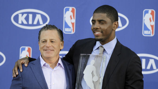 Cleveland Cavaliers' Kyrie Irving, right, poses with Cavaliers' owner Dan Gilbert after Irving was presented with the NBA Rookie of the Year award at the basketball team's headquarters in Independence, Ohio Tuesday, May 15, 2012. (AP Photo/Mark Duncan)