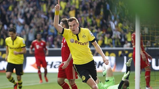Borussia Dortmund's Kevin Grosskreutz celebrates after scoringa goal against Bayern Munich during their German first division Bundesliga soccer match in Dortmund May 4, 2013 (Reuters)