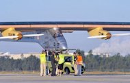 Solar-powered aircraft the Solar Impulse, piloted by Bertrand Piccard of Switzerland, prepares for take-off from Rabat on June 21 for a voyage across the Moroccan desert, to Ouarzazate. The Swiss-made plane early Friday completed a flight over the Moroccan desert to showcase renewable energy, as a key summit in Rio discussed &quot;greening&quot; the world economy