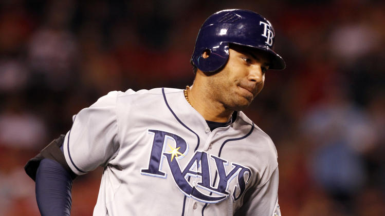Tampa Bay Rays' Carlos Pena, runs the bases after hitting a two run home run in the eighth inning of a baseball game against the Los Angeles Angels in Anaheim, Calif., on Saturday, Aug. 18, 2012. (AP Photo/Christine Cotter)