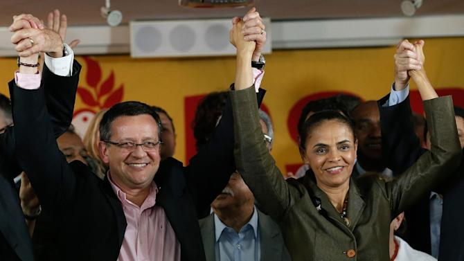 Brazilian Socialist Party (PSB) presidential candidate Marina Silva, right, and her running mate Beto Albuquerque, celebrate the launch of their candidacy for the presidential elections at the headquarters of the Brazilian Socialist Party in Brasilia, Brazil, Wednesday, Aug. 20, 2014. (AP Photo/Eraldo Peres)