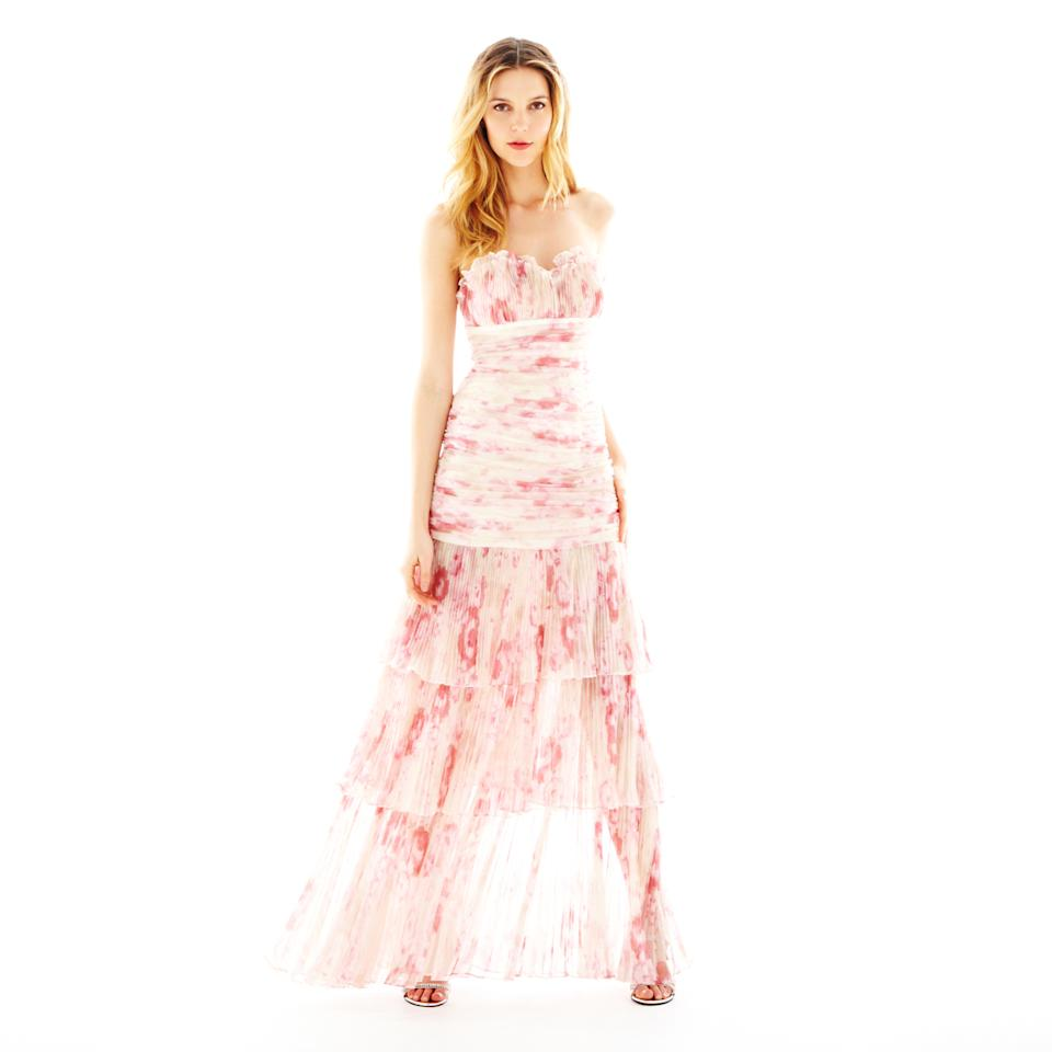 This product image released by J.C. Penney shows a strapless tiered print dress from the collection of Pearl by Georgina Chapman of Marchesa.  Chapman, designer of red-carpet favorite Marchesa, is now offering a significantly less expensive version of her party looks at J.C. Penney under the Pearl label. (AP Photo/J.C. Penney)