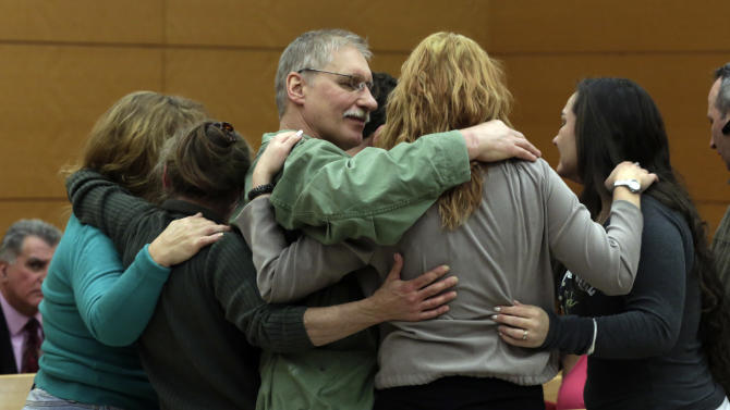 David Ranta, who was convicted of murder in the 1990 cold-blooded slaying of Rabbi Chaskel Werzberger in Brooklyn and has languished behind bars ever since, is hugged by family members after his was freed, in New York state Supreme Court in the Brooklyn borough of New York, Thursday, March 21, 2013. Ranta, 58, who spent more than two decades behind bars, was freed by a New York City judge after a reinvestigation of his case cast serious doubt on evidence used to convict him. (AP Photo/Richard Drew, Pool)