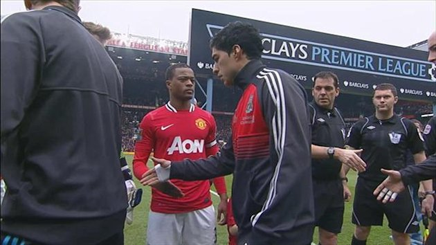 Evra and Suarez handshake
