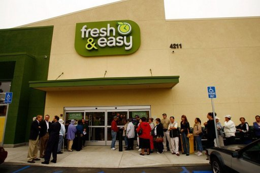 <p>This file photo shows opening day shoppers lining up at a Fresh & Easy grocery store as Britain's Tesco officially entered the US market by opening its first six stores in southern California, in 2007, in Los Angeles. Tesco announced on Wednesday it was launching a strategic review of its struggling Fresh & Easy, which may lead to a sale of the business.</p>