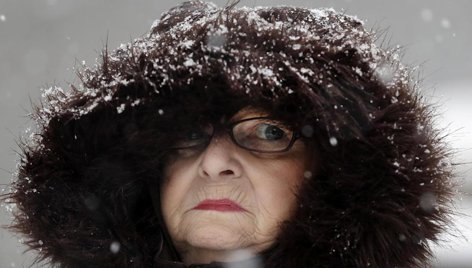 Mary Ann Bova walks along a slippery snow-covered sidewalk during a winter storm in Buffalo, N.Y., Friday, Feb. 8, 2013. In some upstate areas, snow fell early Friday morning and was expected to increase throughout the day, with the heaviest accumulations expected in eastern New York on Friday night.(AP Photo/David Duprey)