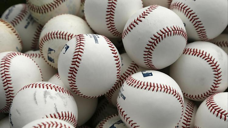 Baseballs sit in a basket before an exhibition baseball game between the Toronto Blue Jays and the Tampa Bay Rays Friday, March 7, 2014, in Dunedin, Fla. (AP Photo/Charlie Neibergall)