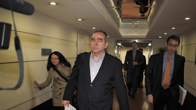 The top U.S. diplomat for East Asia, Kurt Campbell, front,  arrives at a hotel in Beijing, China, in the early morning of Sunday, April 29, 2012.  Campbell arrived in China apparently to deal with the case of blind legal activist Chen Guangcheng who escaped house arrest in his Chinese village and is reportedly under the protection of American officials. Fellow activists say Chen Guangcheng, a blind lawyer who exposed forced abortions and sterilizations as part of China's one-child policy, fled house arrest a week ago and has sought protection at the U.S. Embassy in Beijing. (AP Photo/Ng Han Guan)