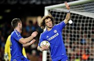 Chelsea&#39;s Brazilian defender David Luiz (R) celebrates scoring a penalty in the UEFA Champions League match against FC Nordsjaelland on December 5. The Blues routed Nordsjaelland 6-1 to secure a first victory under interim manager Rafael Benitez, but it wasn&#39;t enough to book a place in the last 16 as Chelsea became the first European champions to bow out at the group stage