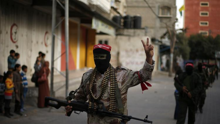 Palestinians militants from PFLP march during an anti Israeli parade in Jabalya in Gaza
