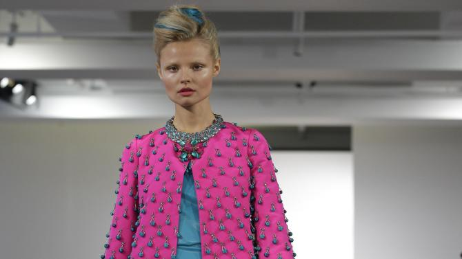 A model walks the runway during the presentation of the Oscar de la Renta Spring 2013 collection at Fashion Week in New York, Tuesday, Sept. 11, 2012.  (AP Photo/Kathy Willens)