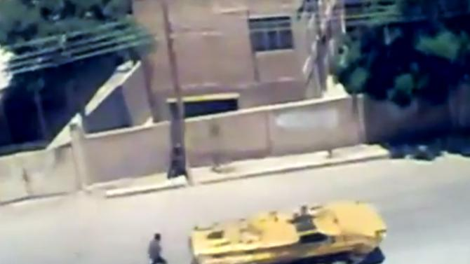 This image made from amateur video released by Ugarit News and accessed Saturday, June 16, 2012, purports to show a Syrian military tank in, Damascus, Syria. The Syrian government, intent on wresting back control of rebel-held areas, launched a fierce offensive in recent days to recover territories in several locations, shelling heavily populated districts and using attack helicopters over towns and cities. (AP Photo/Ugarit News via AP video) TV OUT, THE ASSOCIATED PRESS CANNOT INDEPENDENTLY VERIFY THE CONTENT, DATE, LOCATION OR AUTHENTICITY OF THIS MATERIAL