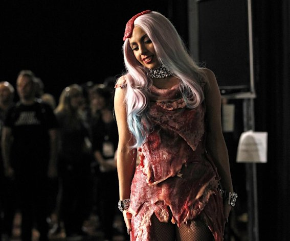 "FILE - In this Sept. 12, 2010 file photo, singer Lady Gaga walks backstage wearing a dress made of meat after accepting the award for video of the year for ""Bad Romance"" at the MTV Video Music Awards in Los Angeles. The dress has made its way to Washington, along with Loretta Lynn's song about ""The Pill"" and other relics from music history. Lady Gaga's dress from the 2010 MTV Video Music Awards is being displayed at the National Museum of Women in the Arts with an explanation of her political message. (AP Photo/Matt Sayles, file)"