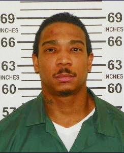 "FILE - In this Feb. 1, 2013, photo provided by the New York State Department of Corrections and Community Supervision, Jeffrey Atkins, also known as the rapper ""Ja Rule"" is shown. Atkins, left a state prison in central New York last week after serving most of his two-year sentence for illegal gun possession, going straight into federal custody in a tax evasion case. (AP Photo/New York State Department of Corrections and Community Supervision)"