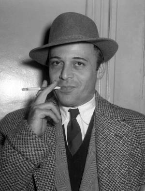 """FILE - An Oct. 28, 1955 photo from files showing British actor Herbert Lom at London Airport prior to his departure to Rome, to continue filming 'War and Peace'. The Czech-born actor who starred as Inspector Clouseau's boss in the Pink Panther movies, has died. He was 95.The London-based star appeared in more than 100 films, including """"Spartacus,"""" ''El Cid"""" and """"The Ladykillers,"""" and acted alongside film greats including Charlton Heston and Kirk Douglas. Lom's son Alec said the actor — who """"never wanted to be pigeonholed in a particular role"""" — died peacefully in his sleep on Thursday, Sept. 27, 2012. (AP Photo)"""