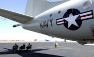 US Navy personnel sit under a P3C Orion Maritime Surveillance aircraft in 2005. The Philippines may ask the United States to send spy planes to help it monitor a disputed area in the South China Sea, a presidential spokesman said. The move to request P3C Orion spy planes would first require the approval of President Benigno Aquino's top defence advisers, Ramon Carandang said