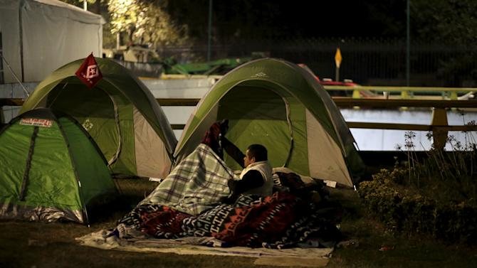 A demonstrator is seen outside a tents as activists, students and relatives of the victims begin a sit-in near in Los Pinos presidential residence, in Mexico City