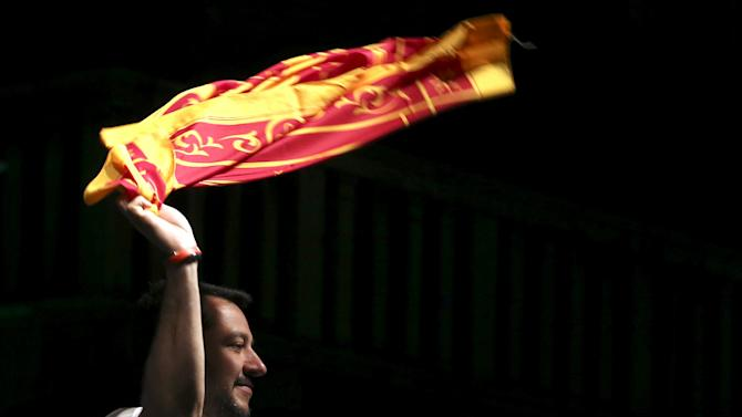 Northern League party leader Salvini waves the Lion of Saint Mark flag on stage during a rally in Verona