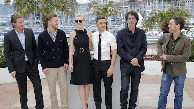 From left, actors Garrett Hedlund, Justin Timberlake, Carey Mulligan, Oscar Isaac, and directors Joel and Ethan Coen pose for photographers during a photo call for the film Inside Llewyn Davis at the 66th international film festival, in Cannes, southern France, Sunday, May 19, 2013. (AP Photo/Lionel Cironneau)