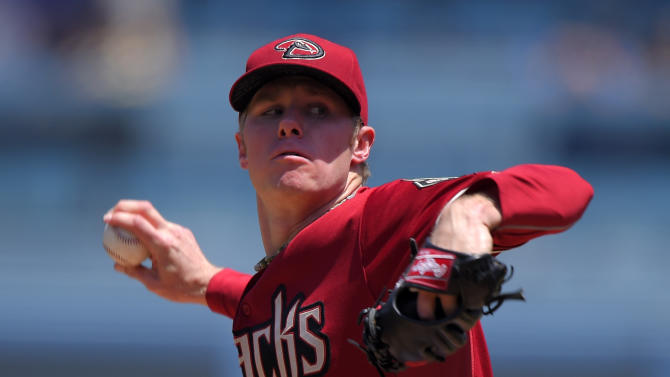 Arizona Diamondbacks starting pitcher Chase Anderson throws to the plate during the first inning of a baseball game against the Los Angeles Dodgers, Sunday, May 3, 2015, in Los Angeles. (AP Photo/Mark J. Terrill)