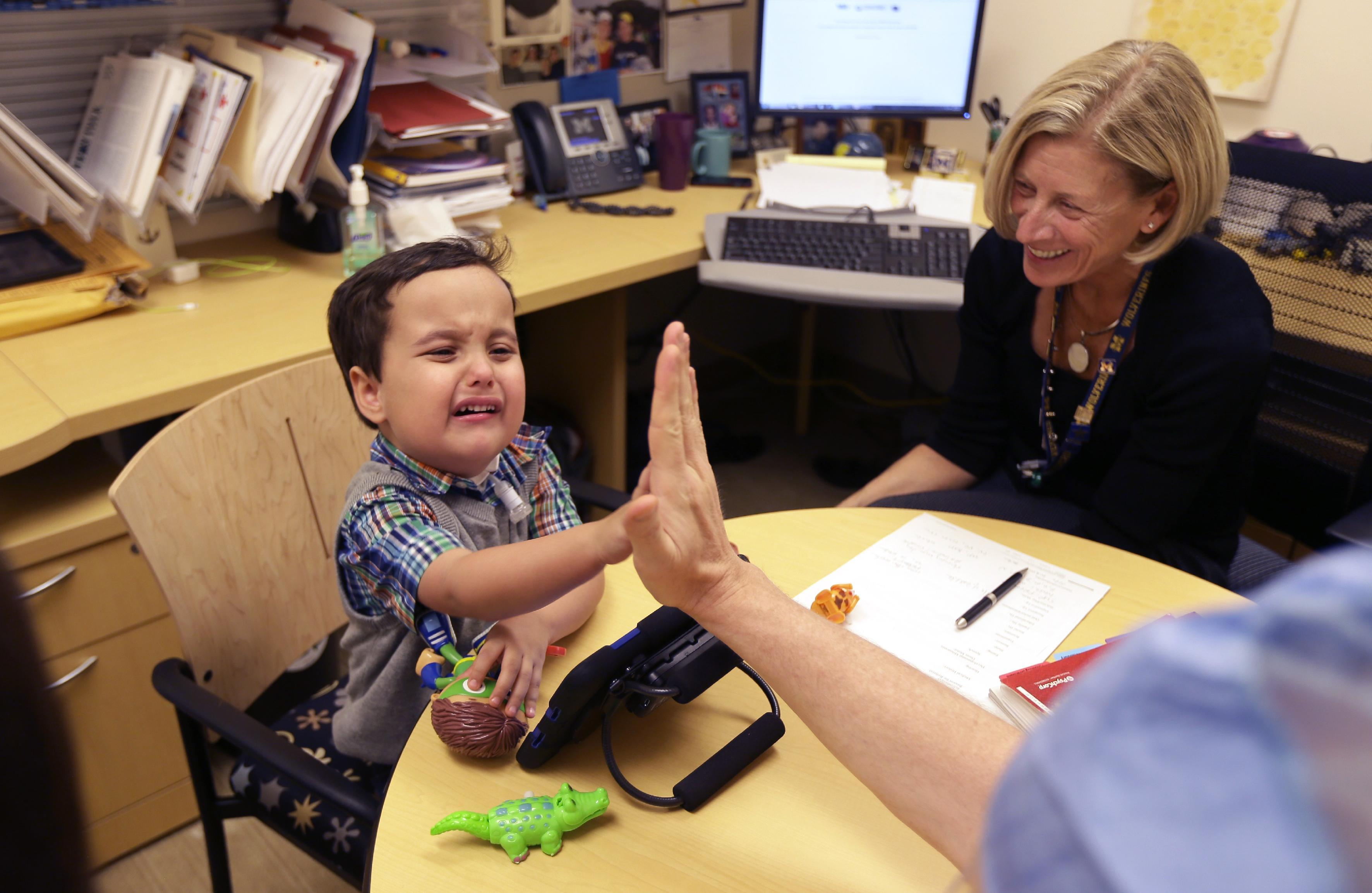 Born with no voice & low odds, boy talks with new voice box