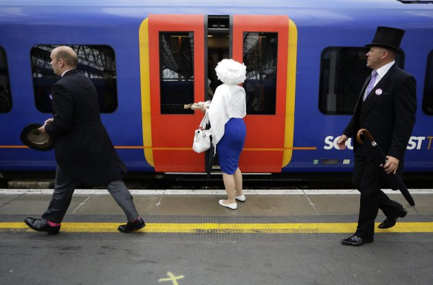 People board a train bound for Ladies' Day at the Royal Ascot horse racing festival in London