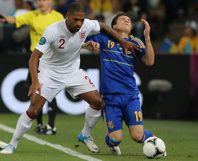 English Defender Glen Johnson (L) Tackles AFP/Getty Images