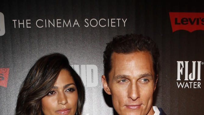 "Model Camila Alves and Matthew McConaughey arrive for The Cinema Society's screening of ""Mud"" presented by FIJI Water, Sunday, April 21, 2013, in New York. (Photo by Jason DeCrow/Invision for FIJI Water/AP Images)"