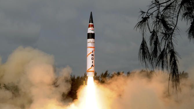 In this photo released by Indian Ministry of Defense, India's Agni-V missile, with a range of 5,000 kilometers (3,100 miles), lifts off from the launch pad at Wheeler Island off India's east coast, Thursday, April 19, 2012. India announced Thursday that it had successfully test launched a new nuclear-capable missile that would give it, for the first time, the capability of striking the major Chinese cities of Beijing and Shanghai. (AP Photo/Indian Ministry of Defense) EDITORIAL USE ONLY