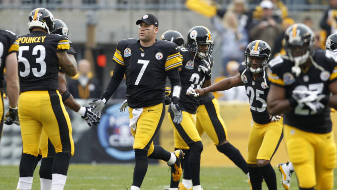 Pittsburgh Steelers quarterback Ben Roethlisberger (7) is greeted by teammates after being introduced as the starting quarterback of an NFL football game against the San Diego Chargers on Sunday, Dec. 9, 2012 in Pittsburgh. Roethlisberger had been out for two games with injured ribs.(AP Photo/Keith Srakocic)