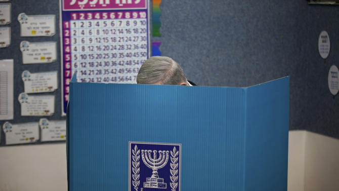 Israeli Prime Minister Benjamin Netanyahu casts his ballot at a polling station in Jerusalem, Tuesday, Jan. 22, 2013. Israelis headed to polling stations Tuesday to cast votes in a parliamentary election expected to return  Netanyahu to office despite years of stalled peacemaking with the Palestinians and mounting economic troubles. (AP Photo/Uriel Sinai, Pool)