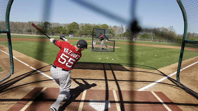 Boston Red Sox catcher Christian Vazquez takes batting practice during spring training baseball practice Tuesday, Feb. 18, 2014, in Fort Myers, Fla. (AP Photo/Steven Senne)