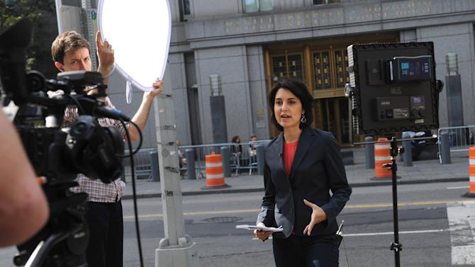 A reporter reports liveoutside Manhattan federal court, Saturday, Oct. 6, 2012, in New York. An ailing extremist Egyptian-born preacher and four other terrorism suspects arrived in the United States from England early Saturday under tight security to face trial, and two appeared within hours in a court in the state of Connecticut. The preacher, Abu Hamza al-Masri, was taken to a lockup next to the federal courthouse in lower Manhattan to face charges that he conspired with Seattle men to set up a terrorist training camp in Oregon and that he helped abduct 16 hostages, two of them American tourists, in Yemen in 1998. (AP Photo/ Louis Lanzano)