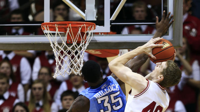 Indiana's Cody Zeller (40) is fouled by North Carolina's Reggie Bullock as he goes up for a shot during the first half of an NCAA college basketball game, Tuesday, Nov. 27, 2012, in Bloomington, Ind. (AP Photo/Darron Cummings)